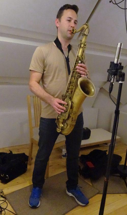 Konrad Wiszniewski recording saxophone at Jennifer Clark's studio